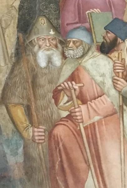 Het detail van een veel groter fresco waarop de schilder Andrea Bonaiuto de triomf van de Kerk afbeeldde, toont een groepje pelgrims waarvan er één een haren kleed draagt en een hoed waarop drie bedevaartssouvenirs zijn bevestigd. Een stelt waarschijnlijk een  loodtinnen insigne voor. De tweede is een schelp van Santiago de Compostela. De laatste is een rechthoekig plaatje met een schematische weergegeven gelaat van Christus.