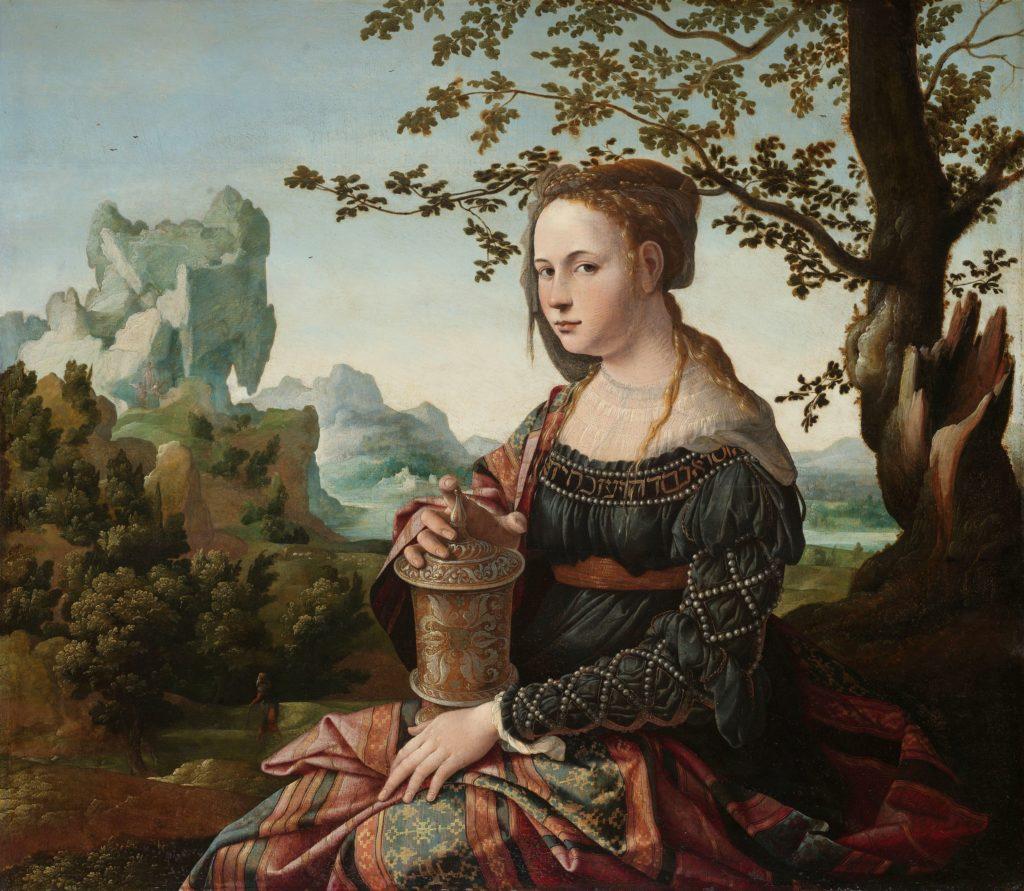 Maria Magdalena zit met zalfpot op schoot in een landdschap met de hoge, kale berg van deSainte-Baume op de achtergrond.