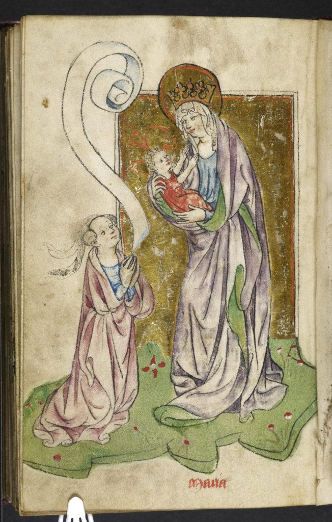 Een vrouw in gebed voor Maria