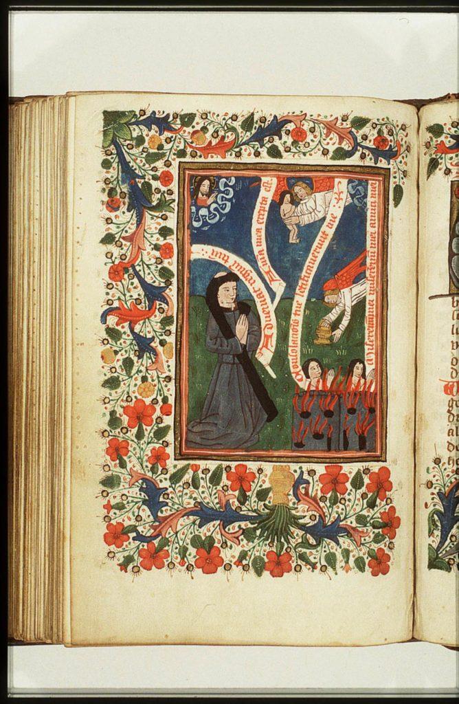 Monnik in gebed met de zielen in het vagevuur